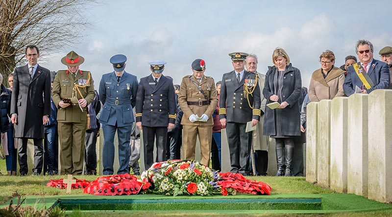 Dignitaries at the burial ceremony of the partial remains of an unknown First World War New Zealand soldier and the partial remains of two British soldiers today at the Perth (China Wall) Commonwealth War Graves Cemetery near Ieper, in Belgium.