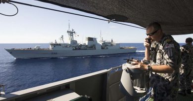 Lieutenant Aaron Norley conning HMAS Ballarat in company with the Royal Canadian Navy ship HMCS Winnipeg conduct Officer of the Watch manoeuvres during HMAS Ballarat's South East Asia Deployment. Photo by Able Seaman Bradley Darvill.