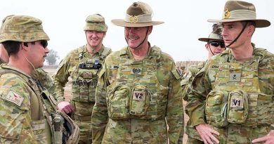 Chief of Army Lieutenant General Angus Campbell (right), and Regimental Sergeant Major-Army Warrant Officer Don Spinks, receive a brief from Sergeant Peter Papalia during a visit to Task Group Taji 4 in Iraq. Photo by Corporal Kyle Jenner.