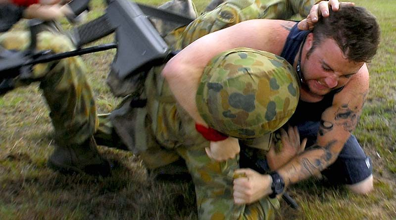 An Australian soldier strugles with a 'protester' on an exercise in Tin Can Bay. Photo by Corporal Chris Moore.