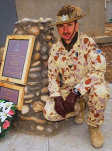Sergeant Pete Rewko, 2nd/14th Light Horse Regiment (Queensland Mounted Infantry) and coordinator/co-builder of a Sunnyside Memorial at Talil, Iraq, displays the cairn after its dedication on 1 January 2008. The memorial commemorates the loss two soldiers – Privates Victor Jones and David McLeod of the Queensland Mounted Infantry – killed in action during the Boer War. Photo by Corporal Rob Nyffenegger.