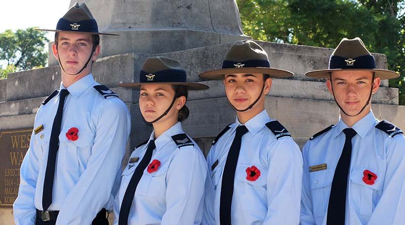 Cadet Sergeant Blake Lawrence, Cadet Sergeant Britney Shorter, Leading Cadet Zain Carse and Leading Cadet Byron Barnes-Williams of No 604 Squadron, wear poppies in the left-brett pocket flap, as allowed in the AAFC dress manual.
