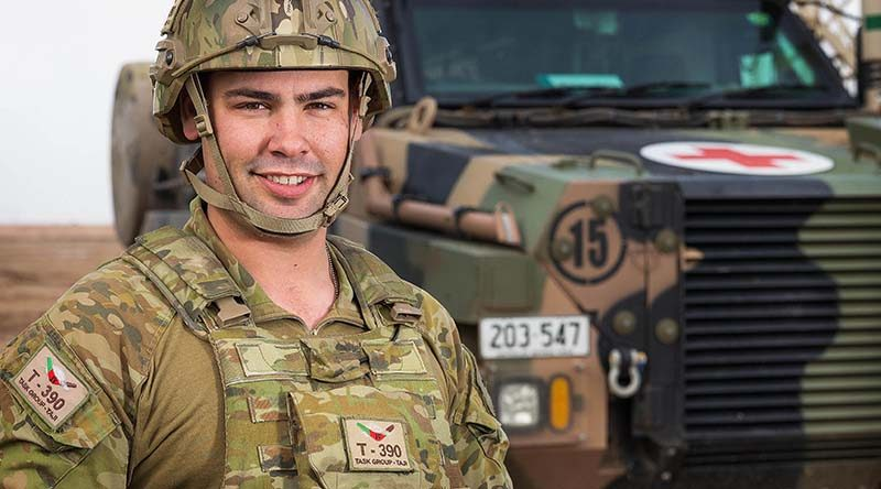 Australian Army soldier Corporal Levi Stripp is serving with Task Group Taji 4 at Taji Military Complex, Iraq, seen here with a Bushmaster Protected Mobility Vehicle - Ambulance. Photo by Corporal Kyle Jenner.