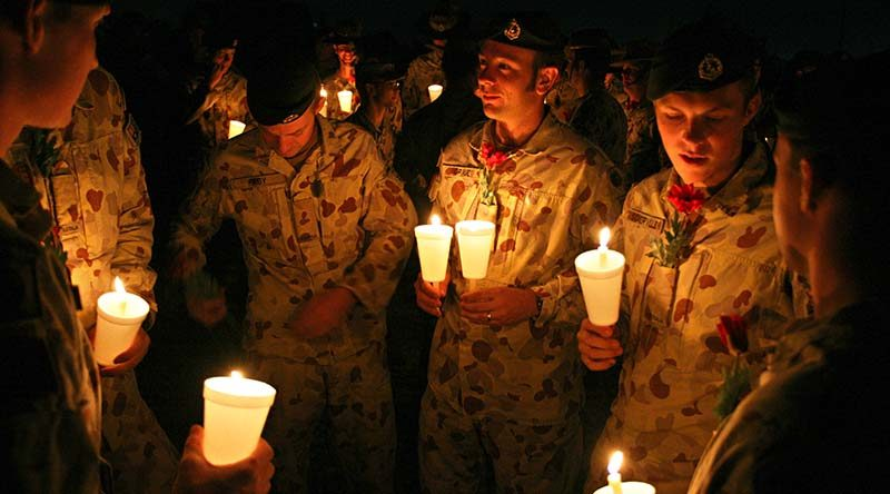 Members of Overwatch Battle Group–West get ready to participate in an ANZAC Day at a Dawn Service at Talil, Iraq, 2008. Photo by Brian Hartigan.