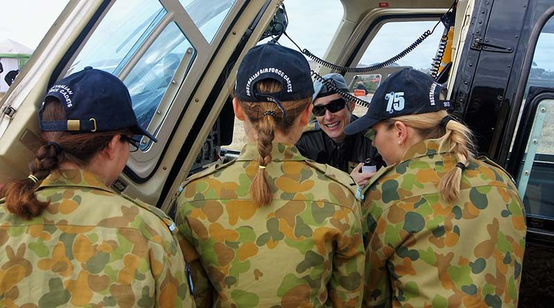 Major Genevieve 'Gen' Rueger shows 6 Wing AAFC Cadets the Defence Force Recruiting Bell Jet Ranger III at the Barossa Air Show. Photo by Pilot Officer (AAFC) Paul Rosenzweig.