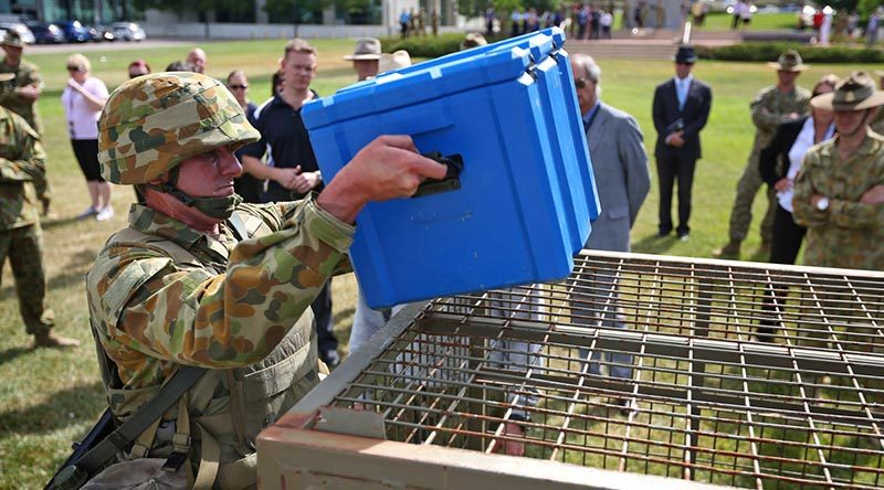 A soldier performs the box lift and place section of the physical employment standards assessment during a demonstration at Russell Offices in Canberra. Photo by Leading Seaman Paul Berry.