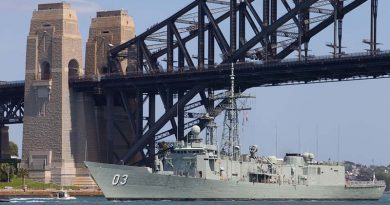 HMAS Sydney (IV) passes under the Sydney Harbour Bridge for the last time. Photo by Able Seaman Adam Porter.