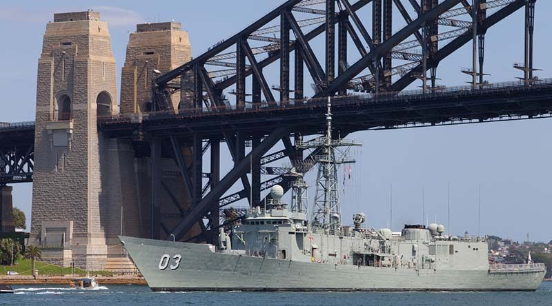 HMAS Sydney (IV) passes under the Sydney Harbour Bridge for the last time. Photo by Able Seaman Adam Porter.