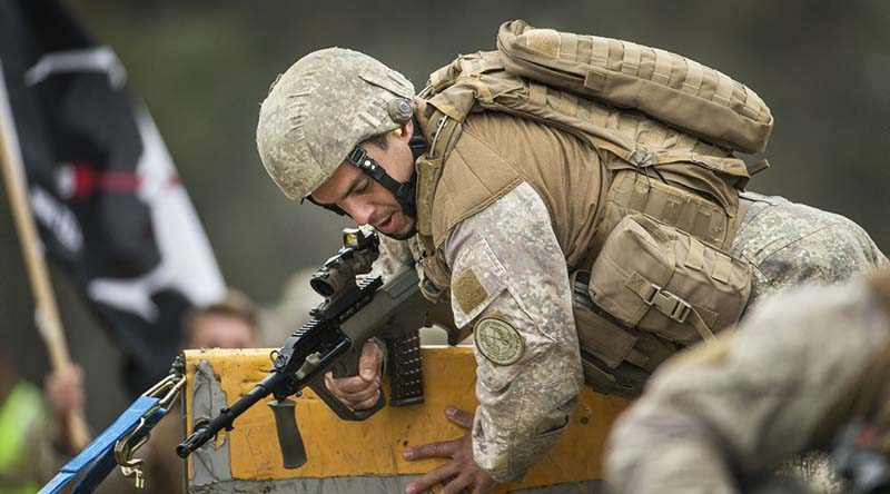 A New Zealand Army soldier clears the wall in an obstacle course match during the Australian Army Skill at Arms Meeting at Puckapunyal, Victoria. Photo by Sergeant Janine Fabre