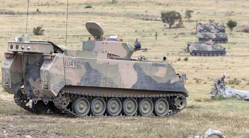 M113AS4 armoured personnel carriers. Photo by Corporal Steve Duncan.