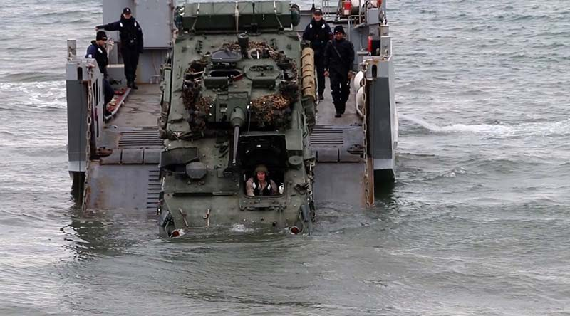 A LAV comes ashore from a landing craft during Exercise Joint Waka. Photo courtesy AirflowNZ.