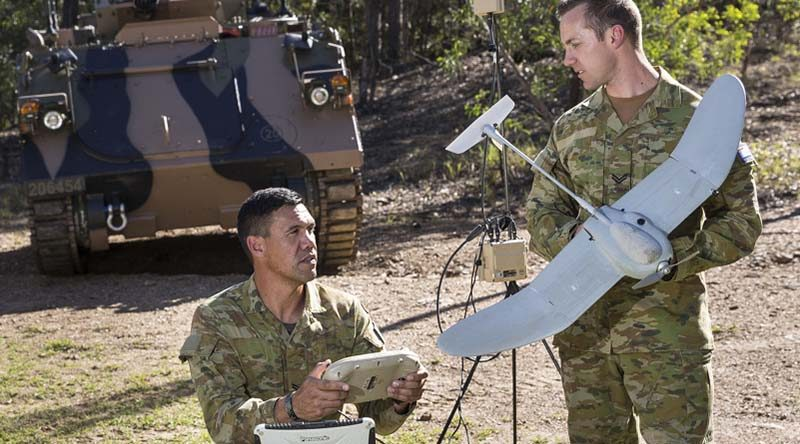 Corporal Matthew Molloy (left) and Corporal Doug Coombs from 2nd/14th Light Horse Regiment (Queensland Mounted Infantry) examine a Wasp unmanned aerial system. While the UAV (unmanned aerial vehicle) is one-man portable, the UAS (system) has a bit more weight to it. Photo by Sergeant Janine Fabre.