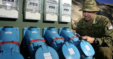 Leading Aircraftman Cameron Lambert, an Electrician from 1 Airfield Operational Support Squadron RAAF Richmond, helps to keep the electricity flowing at RAAF Base Tindal during exercise Talisman Saber 2009. Photo by Corporal Melinda Mancuso.