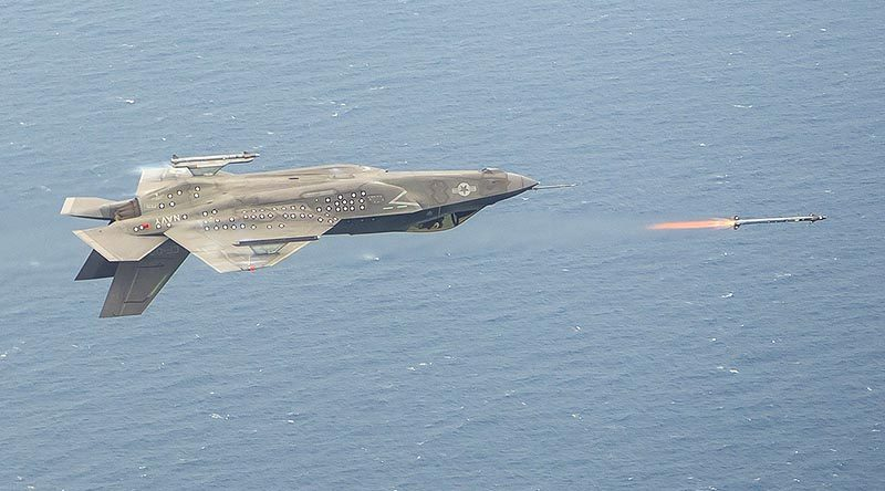 An inverted F-35C, piloted by Major Eric Northam, launches an AIM-9X missile during a live-fire test at Naval Air Station Patuxent River, Maryland, on 8 June. Lockheed Martin photo by Dane Wiedmann.