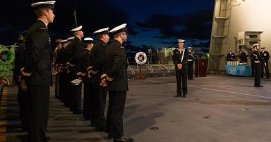 Crewmembers of HMAS Canberra III hold a memorial service to commemorate the 75 Anniversary of the loss of HMAS Canberra I during the Battle of Savo Island.