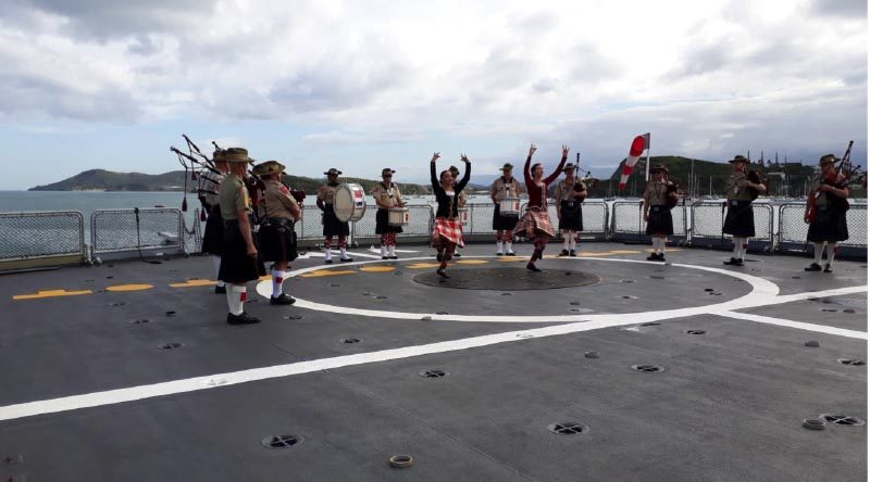 The Pipes and Drums, National Servicemen's Memorial Band, perform aboard a French frigate during a successful trip to New Caledonia. Photo supplied.