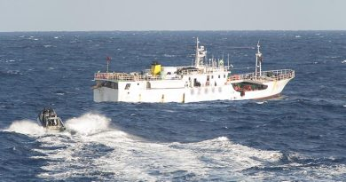 A Zodiac from HMNZS Otago, with fisheries officers from New Zealand and Vanuatu, approaches a fishing vessel in the south-west Pacific during Operation Island Chief. NZDF photo.