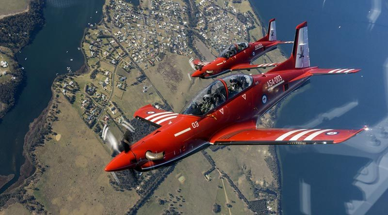 Two of the RAAF's new Pilatus PC-21 training aircraft, A54-003 and A54-004, fly over the Gippsland region. Photo by Flight Lieutenant Ash Kissock.