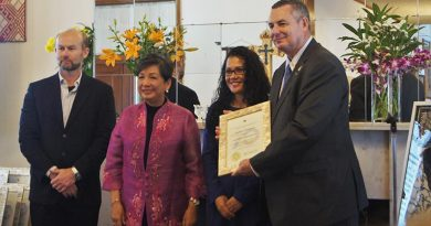 Major Paul Rosenzweig (ret'd), right, receives a Philippines diplomatic relations award from the Philippine Ambassador to Australia (second from left). Image supplied by Philippine Embassy, Canberra