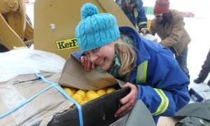 Davis research station Chef Kerryn Oates is happy to see fresh fruit after a long winter. Photo Tony D'Amico, Australian Antarctic Division.