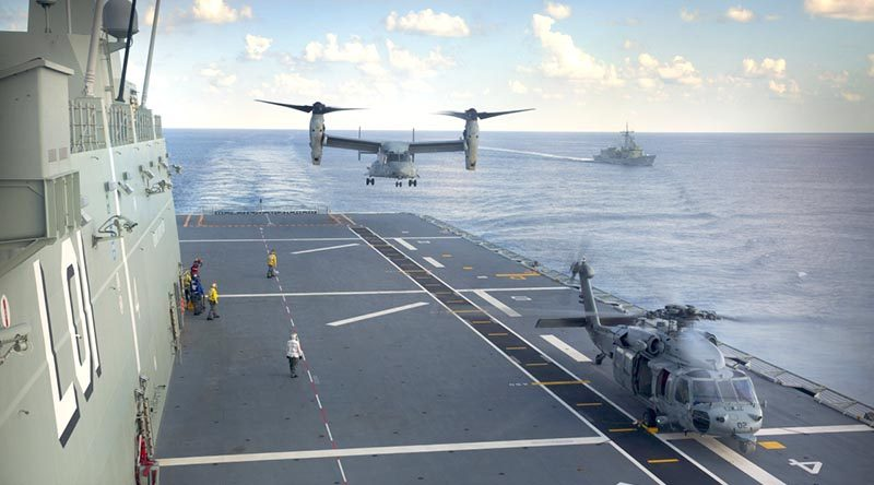 A United States Marine Corps MV-22 Osprey and a United States Navy Seahawk helicopter from USS Bonhomme Richard conduct deck landings on HMAS Adelaide, with HMAS Darwin in the background during Indo-Pacific Endeavour 2017. Photo by Petty Officer Andrew Dakin.