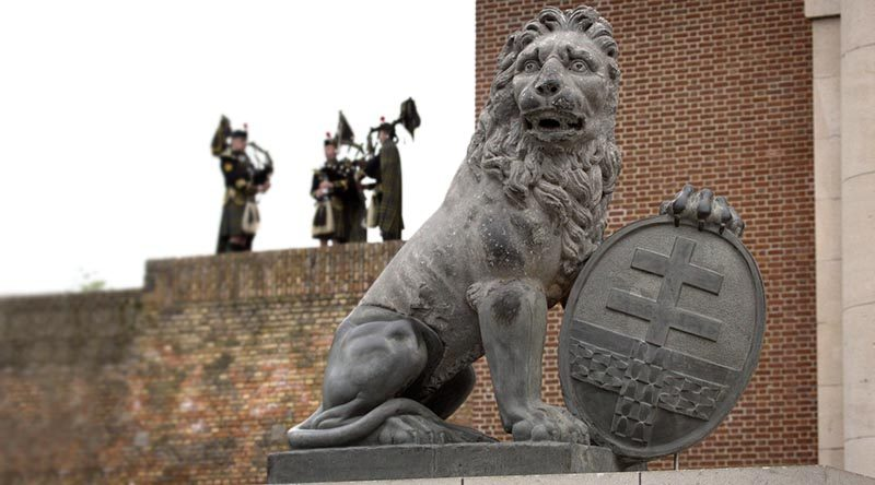 A Menin Gate Lion sits in front of the Menin Gate Memorial in Ieper, Belgium. Photo by Sergeant Christopher Dickson.