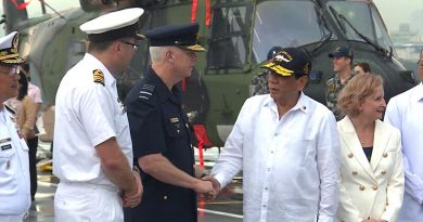 Philippines President Rodrigo Duterte is greeted by Australia's Chief of Defence Force Air Chief Marshal Mark Binskin during a visit aboard HMAS Adelaide in Manila. Photo by Leading Seaman Peter Thompson.