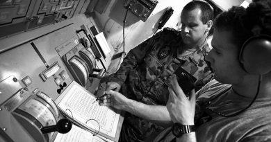 Mentoring below decks on HMAS Melbourne, Persian Gulf. Photo by Brian Hartigan, 2012.