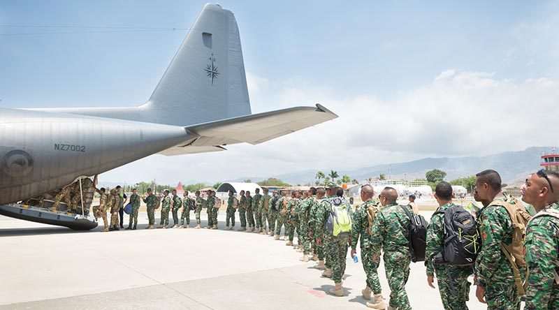 Troops from Timor Leste and Papua New Guinea file into a Royal New Zealand Air Force C-130 Hercules on their way to New Zealand for exercise Southern Katipo. NZDF photo.
