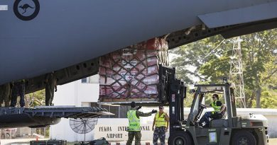 RAAF Sergeant Matt Jones (centre) directs Leading Aircraftwoman Laura Gale as she removes a pallet of Australian Aid supplies from a C-17 Globemaster in Vanuatu during Operation Vanuatu Assist 2017. Photo by Leading Seaman Jake Badior.