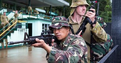 Philippine Army soldier Corporal Dennis Nalugon conducts urban-combat training with Australian soldier Lance Corporal Adam Seaman from the 3rd Brigade, at Capinpin, Philippines, as part of Operation Augury. Photo by Corporal Kyle Genner.