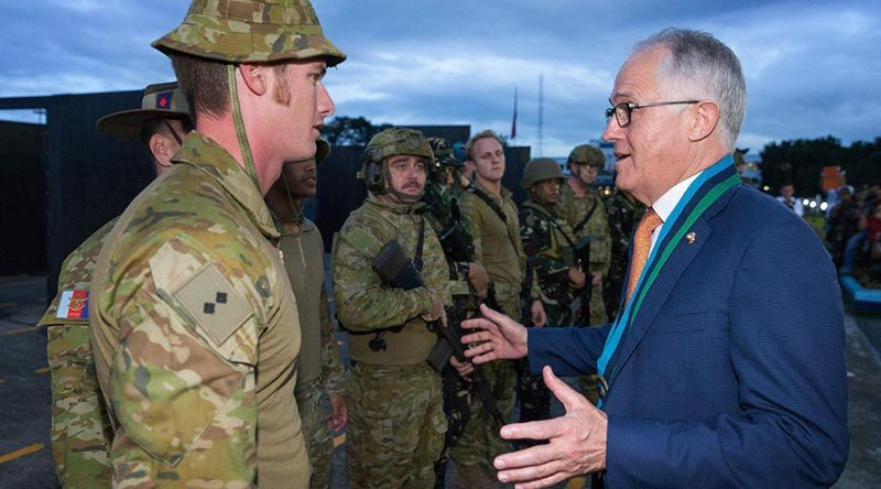 Australian Army officer Lieutenant Wes Walsh talks with Prime Minister of Australia Malcolm Turnbull after an urban-combat-skills demonstration at the Armed Forces of the Philippines Headquarters in Manila. Photo by Corporal Kyle Genner.