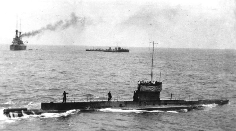 Last known image of AE1, 9 September 1914 – five days before she was lost – with HMAS Ships Australia and Yarra in the background.