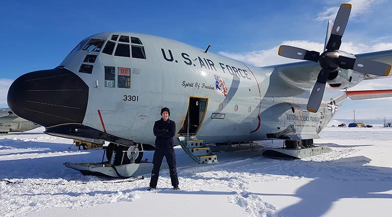 Aircraft Technician Corporal Wade Phelps from the Royal New Zealand Air Force with a US LC-130 'Skibird' at Williams Field in Antarctica. NZDF photo.