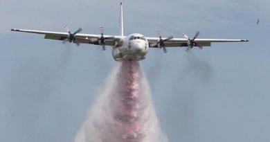 """""""Thor"""", a L-382G Hercules firefighting aircraft contracted to the NSW Rural Fire Service from Coulsan, performing a water bombing display. Photo by Corporal David Gibbs."""