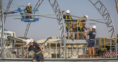 Airfield Engineers use elevated work platforms to insert cross bracing while constructing aircraft flightline shelters in the Middle East Region. Photo by Corporal Brenton Kwaterski.