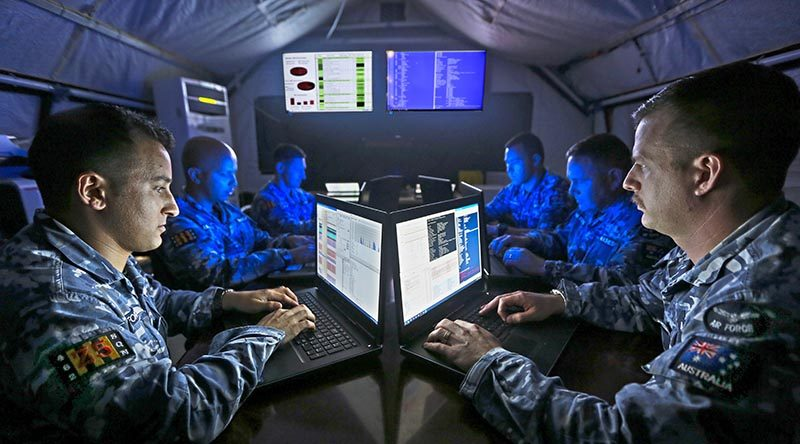 No. 462 Squadron cyberspace security specialists conduct information-assurance activities on deployed mission systems at the main air operating base in the Middle East Region. Photo by Corporal Brenton Kwaterski.