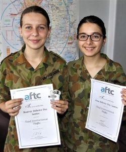 Leading Cadets Ana and Beatriz Ribeiro Dos Santos of No 613 Squadron, AAFC, with certificates awarded by Flight Training Adelaide.
