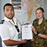 Jimmy from Flight Training Adelaide presents a certificate to Leading Cadet Jade Curwood of No 613 Squadron, AAFC.