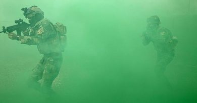 Iraqi Army Rangers storm a building during an Australian-led training activity. Photo by Corporal Steve Duncan.