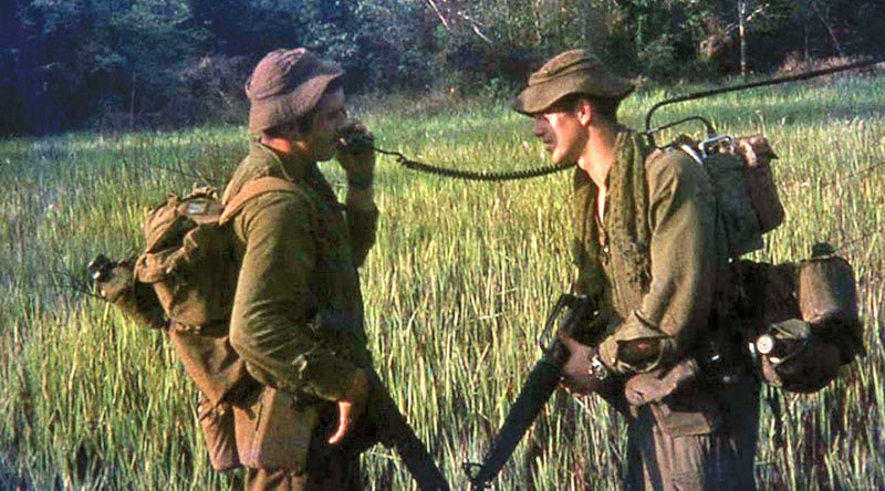 "Ian Cavanough (right) showing Roy how to use a radio properly. ""He was always seeking my advice."""