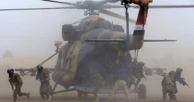 Iraqi Army Rangers disembark from an Iraqi Army MI-17 helicopter during the Rangers' certification activity at the Taji Military Complex, Iraq. Photo by Corporal Steve Duncan.