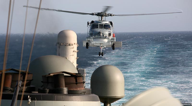 An S-70B-2 Seahawk helicopter comes in for a landing on HMAS Melbourne in the Middle East. Photo by Brian Hartigan.