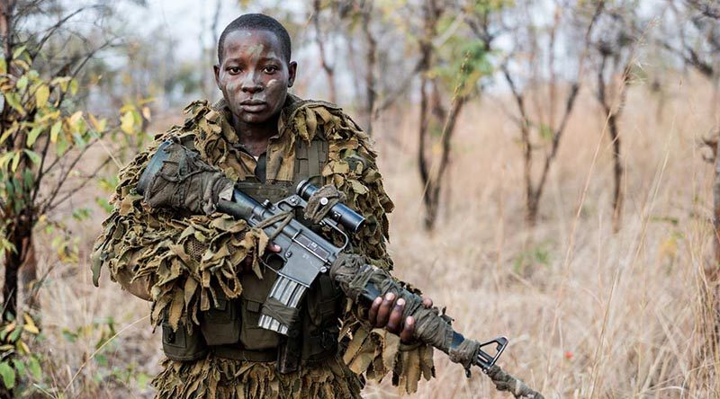 Eighteen-year-old Abigail Malzanyaire, a member of the International Anti Poaching Foundation's Akashinga Program. Photo by Adrian Steirn for Alliance Earth (via IAPF web site).
