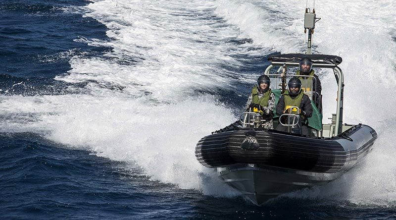 Able Seaman Combat Specialist Daniel Peihopa, RNZN drives one of HMAS Warramunga's sea boats with Leading Seaman Combat Specialist Te Orangapumau Elia, RNZN (right) and Able Seaman Boatswains Mate Bridget Hopkins (left) during Warramunga's deployment to Operation Manitou. Photo by Leading Seaman Tom Gibson.