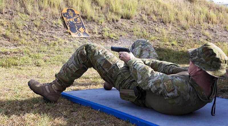 A RAAF Officer practices alternate firing positions with a pistol as part of the ISET-Tactical training aimed at improving his individual combat skills. Photos by Sergeant Amanda Campbell.