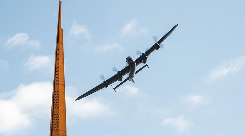 BBMF Lancaster over Memorial Spire November 2015. International Bomber Command Centre official photo.