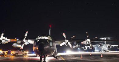 A Royal New Zealand Air Force C-130 Hercules in front of a Royal Australian Air Force C-17 Globemaster at Fuaamotu International Airport, Tonga. NZDF photo.