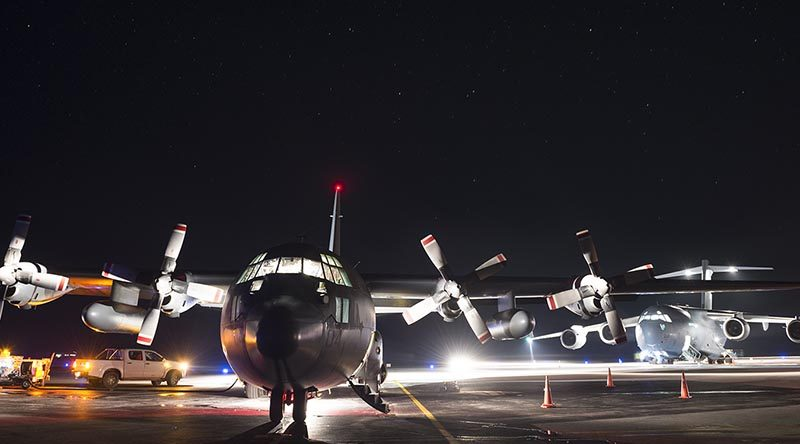 A Royal New Zealand Air Force C-130 Hercules in front of a Royal Australian Air Force C-17 Globemaster at Fuaamotu International Airport, Tonga. NZDF photo.