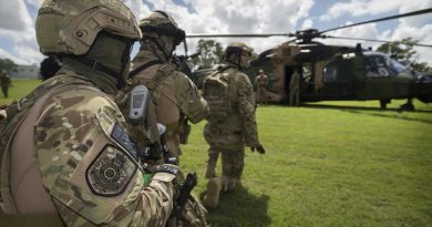Queensland Police Service Special Emergency Response Team tactical operators await the all-clear signal during familiarisation drills with an Australian Army MRH90 helicopter in preparation for the 2018 Commonwealth Games. Photo by Sergeant W Guthrie.